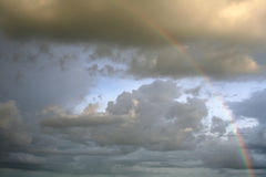 Cloudy rainbow Stock Images