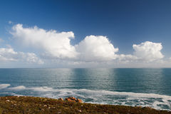 Cloudy reflection. Clouds reflected in a mirror-like ocean Royalty Free Stock Image