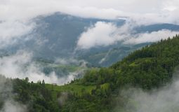 Cloudy Rural Mountain Landscape With Summer Morning Fog In Matisesti Area Of Apuseni National Park, Romania. Beautiful Countryside stock photography