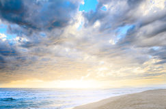 Cloudy sea sunset. Dramatic cloudy sunset at seaside Stock Photo