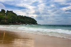 Cloudy with seascape and beach in tropical.Beach and sea with wave. stock photo