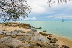 Cloudy seascape with rocky shore on Samui island, Thailand. Cloudy seascape with rocky shore in Thailand Stock Image