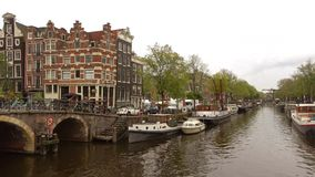 Cloudy september day on the canal city Amsterdam, Netherlands. AMSTERDAM, NETHERLANDS - SEPTEMBER 30, 2017: Cloudy september day on the canal city stock video