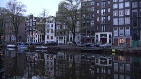 Cloudy september morning on the city channel. Amsterdam. AMSTERDAM, NETHERLANDS - SEPTEMBER 30, 2017: Cloudy september morning on the city channel stock video
