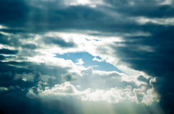 Cloudy Skies. A variety of different types of clouds and sunbeams Stock Image