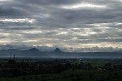 Cloudy skies and the mountain in the mist. Cloudy skies and the mountains in the mist and town view from the mountain Stock Photo