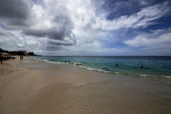 Cloudy skies on Nassau Beach Stock Images