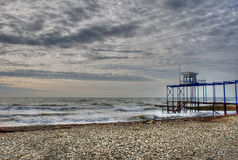 Cloudy skies over beach. A scene of a rocky beach with overcast skies Stock Photography