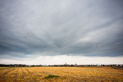 Cloudy skies over empty fields Stock Images