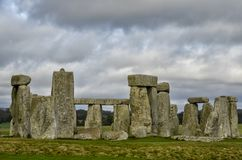 Cloudy skies over Stonehenge in England stock images