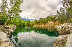 Cloudy skies and reflections at a quarry Royalty Free Stock Photo