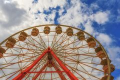 Cloudy skies and the top of a ferris wheel Stock Photo