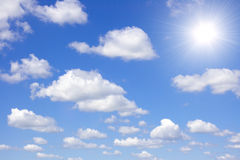 Cloudy sky. More dark blue cloudy sky and bright sun Royalty Free Stock Image