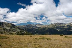 Cloudy sky. Blue sky with clouds in Rila mountains, Bulgaria Stock Images