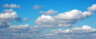Cloudy sky. Fluffy clouds in blue sky royalty free stock photo