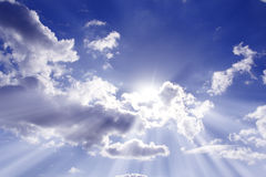 Cloudy sky. A dramatic cloudy sky, with gray clouds and the sun behind a cloud Royalty Free Stock Images