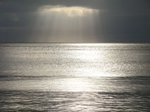 Cloudy sky. With rays of light over the sea Royalty Free Stock Photography