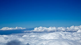 Cloudy Sky. White clouds billow under blue skies Royalty Free Stock Photography
