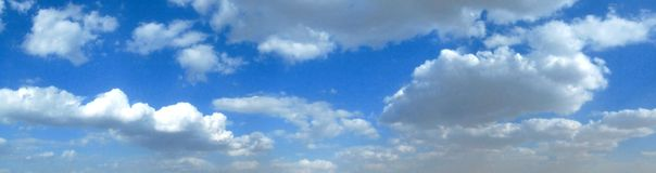 Cloudy sky. Panoramic view of summer cloudy blue sky Royalty Free Stock Photos