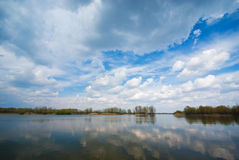 Cloudy sky. And lake (can be use how background, wallpaper, texture Royalty Free Stock Photo