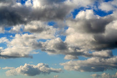 Cloudy sky. Rain clouds start to build in a blue sky Stock Image