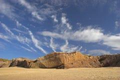 Cloudy sky. In the beach stock photos