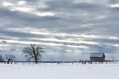 Cloudy Sky Above Barn royalty free stock image