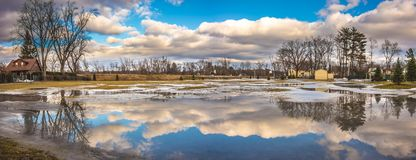 Cloudy Sky above the City of Westfield. Cloudy Sky in the City of Westfield, State of Massachusetts, Beautiful panoramic view and reflection in water Stock Photos
