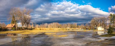 Cloudy Sky above the City of Westfield. Cloudy Sky in the City of Westfield, State of Massachusetts, Beautiful panoramic view and reflection in water Stock Photo