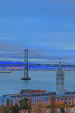 The Cloudy Sky above Ferry Building & Bay Bridge Royalty Free Stock Photo