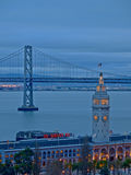 The Cloudy Sky above Ferry Building & Bay Bridge Stock Images