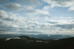 Cloudy sky above  mountains Stock Photo