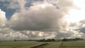 Cloudy sky behind train window. Buildings on the field. Passing by a village. Point of route in countryside stock video footage