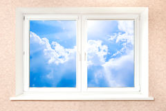 Cloudy sky behind white window Stock Photos