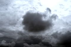 Cloudy sky with a big cloud highlighting. Picture of Cloudy sky with a big Gray cloud highlighting Royalty Free Stock Images