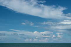 Cloudy sky and blue ocean Stock Photo
