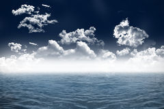 Cloudy sky and blue ocean Stock Image