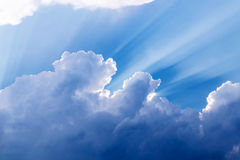 Cloudy sky. Blue sky with rays and clouds. Summer day before the storm Royalty Free Stock Image