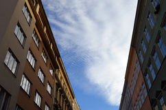 Cloudy sky between buildings. Autumn, cloudy sky between old buildings in Prague in afternoon, Czech Republic Stock Images