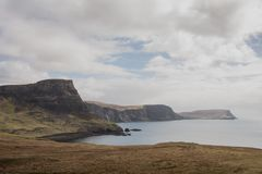 Landscapes of the Isle of Skye. Cloudy sky and the Cliff`s Landscapes in the Isle of Skye, Scotland UK Royalty Free Stock Photography