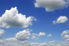 Cloudy sky. Clouds and blue sky ahead. Sunny summer day Stock Image