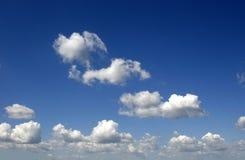 Cloudy sky. Clouds and blue sky ahead. Sunny summer day Stock Photos