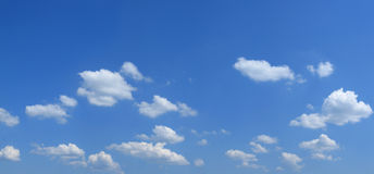 Cloudy sky. Clouds and blue sky ahead. Sunny summer day Stock Photography