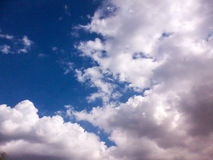 Blue Sky and puffy clouds Stock Images