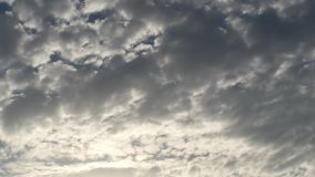 Cloudy sky. Clouds with sunlight peeking through Stock Photo