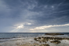 Cloudy sky with coast, Is Aruttas, Sardinia Stock Photo