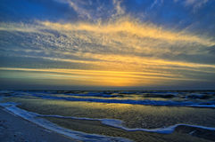 Cloudy sky and colorful sunrise on the sea Stock Image
