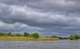 Cloudy sky. In Danube Delta, Romania Stock Photos