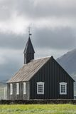Cloudy sky, dark church in Budir, Iceland Stock Photo