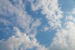 Cloudy sky in daytime. Cloudy sky with sunlight in daytime Royalty Free Stock Image